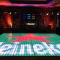 verlichte dansvloer pixel logo