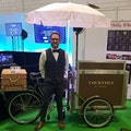 Cocktail tricycle with uniformed server