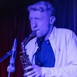 book saxophonist Olly